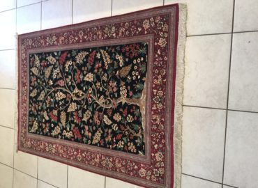 What makes a rug an antique or collectable?